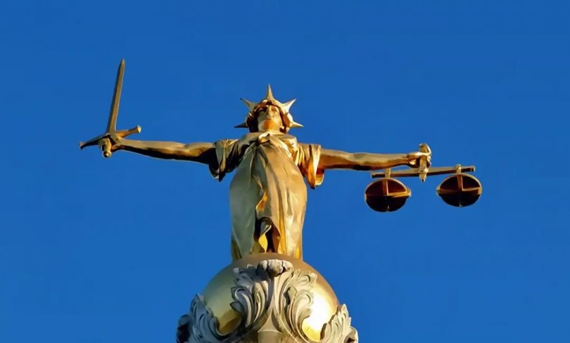 Idealized Lady Justice on Old Ba