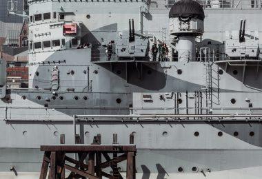 royal navy grey battleship in dock